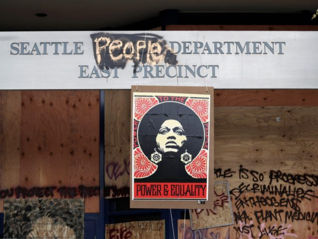 A 1970's-era poster of activist Angela Davis hangs at a boarded up and closed Seattle police precinct Sunday, June 21, 2020, in Seattle, where streets are blocked off in what has been named the Capitol Hill Occupied Protest zone. Police pulled back from several blocks of the city's Capitol Hill …