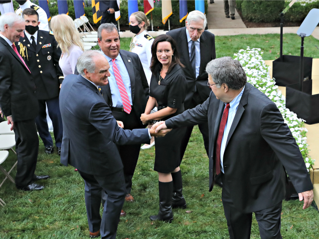 WASHINGTON, DC - SEPTEMBER 26: Attorney General William Barr (R) says goodbye to former New Jersey Governor Chris Christie and other guests after President Donald Trump introducee 7th U.S. Circuit Court Judge Amy Coney Barrett, 48, as his nominee to the Supreme Court in the Rose Garden at the White …