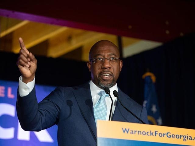 ATLANTA, GA - NOVEMBER 03: Democratic U.S. Senate candidate Rev. Raphael Warnock speaks during an Election Night event on November 3, 2020 in Atlanta, Georgia. Democratic Senate candidate Rev. Raphael Warnock is running in a special election against a crowded field, including U.S. Sen. Kelly Loeffler (R-GA), who was appointed …