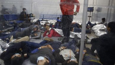 Young children lie inside a pod at the Department of Homeland Security holding facility run by the Customs and Border Patrol (CBP) on March 30, 2021 in Donna, Texas. The Donna location is the main detention center for unaccompanied children coming across the U.S. border in the Rio Grande Valley. …