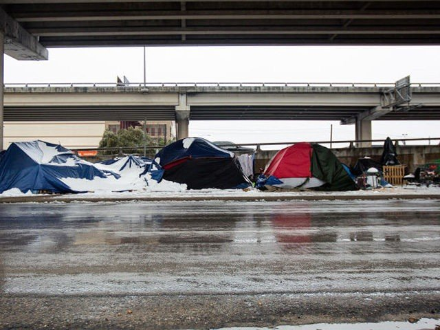 AUSTIN, TX - FEBRUARY 17, 2021: Homeless camps sit along the I-35 frontage road in Austin, Texas on February 17, 2021. Millions of Texans are still without water and electric as winter storms continue. (Photo by Montinique Monroe/Getty Images)