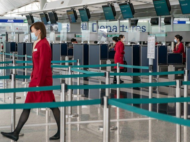 Cathay Pacific ground support workers at check in counter at the Hong Kong International Airport on October 21, 2020 in Hong Kong, China. Hong Kong airline Cathay Pacific Airways announced to cut 8,500 jobs and shut down its regional airline unit Cathay Dragon in a corporate restructuring, as it grapples …
