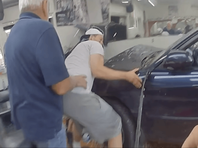 WATCH - Cops, Bystanders Rescue Mom and Baby Trapped Under Car: 'It Was Unbelievable'