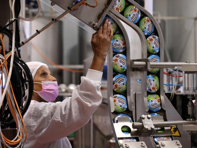 """A labourer works on a production line filling ice-cream pots at the Ben & Jerry's factory in Be'er Tuvia in southern Israel, on July 21, 2021. - Ben & Jerry's announced that it will stop selling ice cream in the Israel-occupied Palestinian territories since it was """"inconsistent with our values"""", …"""