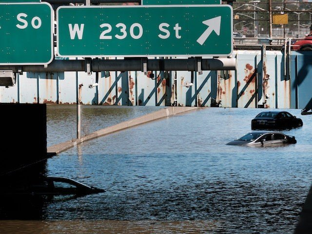 NEW YORK, NY - SEPTEMBER 02: Cars sit abandoned on the flooded Major Deegan Expressway following a night of extremely heavy rain from the remnants of Hurricane Ida on September 02, 2021 in the Bronx borough of New York City. Multiple fatalities have been reported in the region after the …
